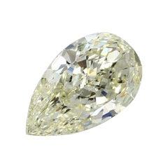 GIA Certified 5.01 Carat Pear Fancy Yellow Diamond