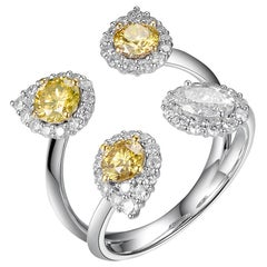 0.92ct Fancy Color Diamond Ring in 18kt Gold and 0.33ct Oval White Diamond