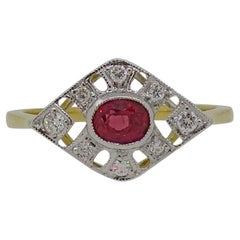 18 Karat Gold Oval Cut Ruby and Diamond Art Deco Style Cluster Ring