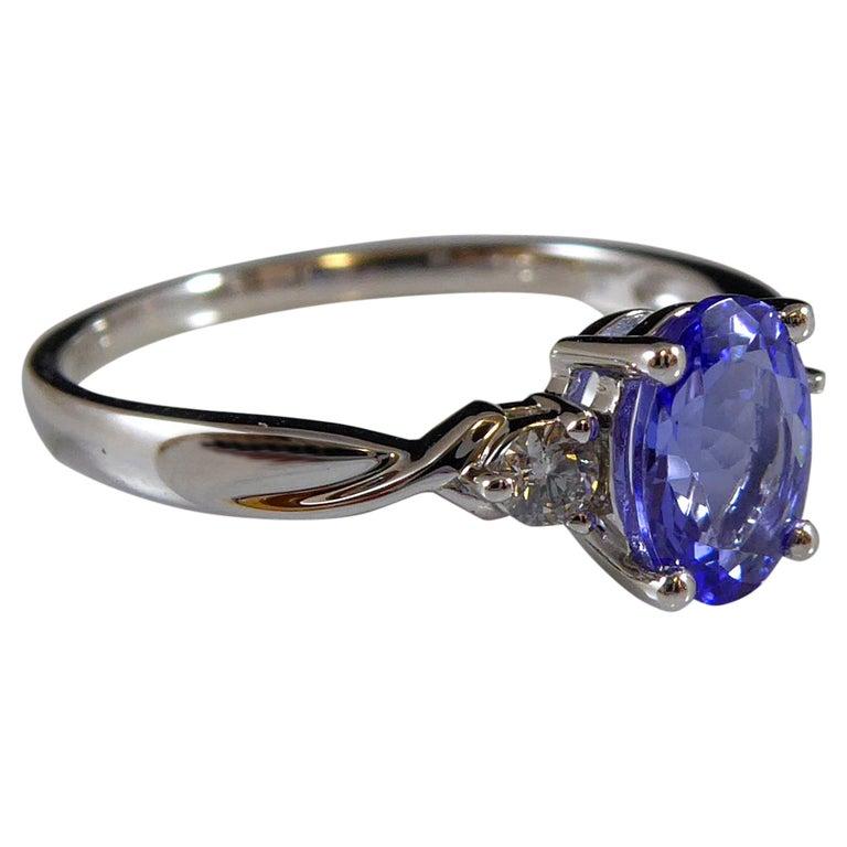Oval Tanzanite and Diamond Three Stone Ring in Platinum For Sale