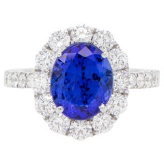 Vivid Blue 3 Carat Oval Tanzanite Ring with 1.46 Carats of Diamonds
