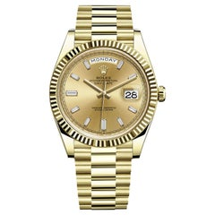 Rolex Day-Date Yellow Gold Champagne Baguette Diamond Dial President 228238
