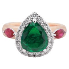 1.05 Carat Vivid Green Emerald Flanked by Ruby Marquise Matt Finish 18K Gold