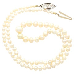 Antique Single Strand Natural Pearl Necklace with 1.02 Carat Diamond Set Clasp