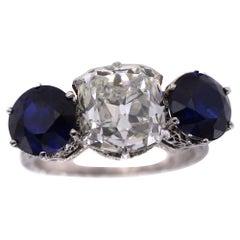 Edwardian 4.04 Carat Cushion GIA Certified Diamond Sapphire 3 Stone Ring