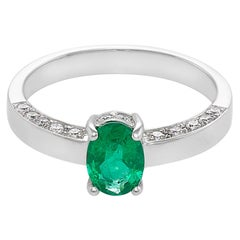 Oval Cut Natural Emerald and Round Brilliant Cut Diamond Engagement Ring