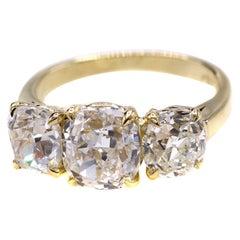 Cushion Brilliant and Old European Cut Diamond Three Stone Ring