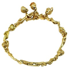 William Ruser Retro Children of the Week Cherub Yellow Gold Bangle Bracelet