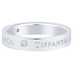 Tiffany & Co. Classic Band Ring, Platinum w/ 3 Round Brilliant Diamonds