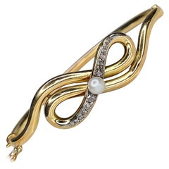 Antique Victorian 18K Yellow Gold Diamond Bow Bangle Bracelet