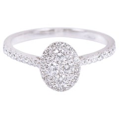 18 Karat White Gold Diamond Solitaire Invisible Setting Cluster Engagement Ring