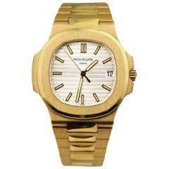 Patek Philippe Nautilus 5711J in 18k Yellow Gold Silver Dial Dual Strap Watch
