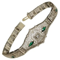 "Art Deco Filigree ""Belly"" Bracelet in 14 Karat Gold with Diamonds and Emeralds"