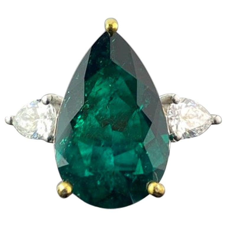 Certified 5.70 Carat Colombian Emerald and Diamond Three Stone Engagement Ring