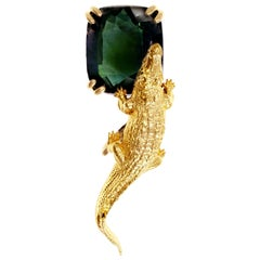 18 Karat Yellow Gold Egyptian Revival Brooch with 11.8 Cts. Green Sapphire