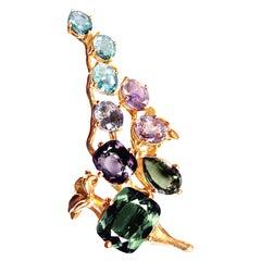 18 Karat Gold Cluster Brooch with 12 Carat Sapphires, and Paraiba Tourmalines