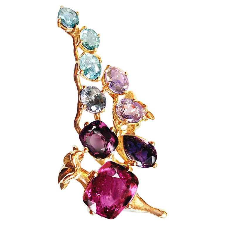 18 Karat Gold Cluster Brooch with 14 Carat Sapphires, and Paraiba Tourmalines For Sale