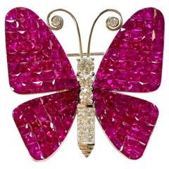 15.99 Carat Invisible Set Ruby and Diamond Brooch