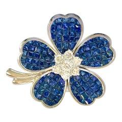 12 Carat Invisible Set Ceylon Sapphire and Diamond Flower Brooch