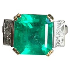 Ring with Emerald 5.95 Carats and 18 Carat White Gold with Diamonds