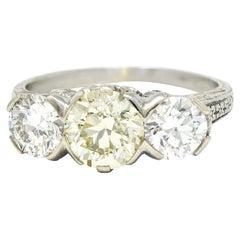 Art Deco 3.20 Carats Diamond & Yellow Diamond 18 Karat Gold Three Stone Ring