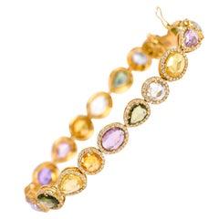18 Karat Gold 19.18 Carat Multi-Sapphire and Diamond Cluster Tennis Bracelet