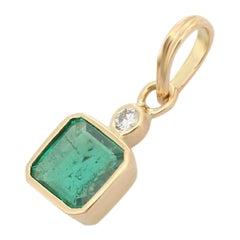 Emerald and Diamond Pendant in 18K Yellow Gold