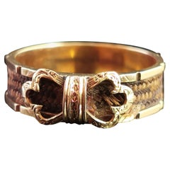 Antique Victorian Mourning Ring, 15 Karat Yellow Gold, Hairwork, Bow Front