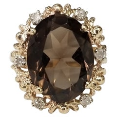 This Beautiful Vintage 14k Yellow Gold Topaz and Diamond Ring