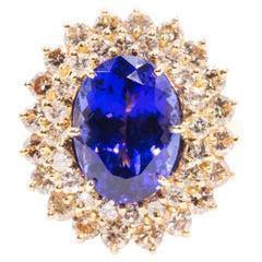 6.40 Carat Oval Tanzanite and 2.20 Carat Diamond 18 Carat Gold Cocktail Ring