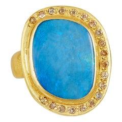 18 Karat Gold Set Around Blue Opal with 20 Brilliant Cut Diamonds