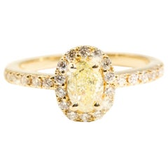 Certified Oval Yellow Diamond and Round White Diamond Halo Engagement Ring
