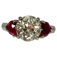 2.5 Carat Round Cut Diamond and Ruby Estate Three-Stone Ring in Platinum