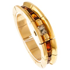 Hermès Ladies Wrist Watch in Yellow Gold and Topaz with Handcuff Shaped Bracelet