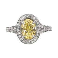 GIA Certified 1.76 Carat Oval Cut Yellow Diamond Halo Engagement Ring