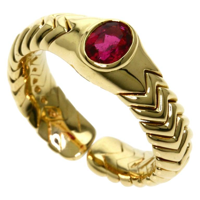 Rare Bvlgari Pink Tourmaline Serpenti Oval Cut 18 Karat Yellow Gold Flex Ring For Sale