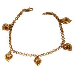 Five Heart Charm Link Bracelet 14 Karat Gold