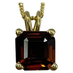 1.32 Carat Deep Orange Tourmaline Emerald Cut 18 Karat Yellow Gold Pendant