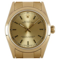 Rolex Oyster Perpetual Mid-Size 18k Yellow Gold Champagne Dial 67488