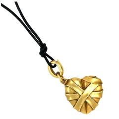 Modern Wrapped 18 Karat Yellow Gold Heart Pendant Necklace by Kieselstein Cord