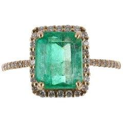 3.0tcw 14K Emerald Cut Emerald & Diamond Halo Ring
