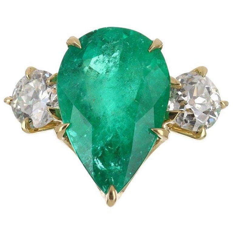 6.68tcw 18K Pear Emerald & Diamond Three Stone Ring