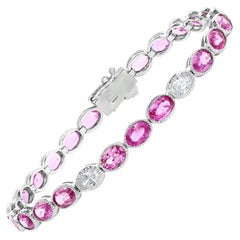 12.62 Carat Oval Cut Pink Sapphire and Diamond Tennis Bracelet in 14K White Gold