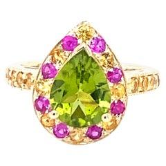 3.16 Carat Peridot Pink Sapphire Yellow Sapphire 14 Karat Yellow Gold Ring