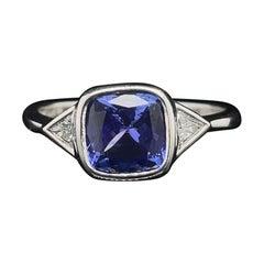 Tanzanite and Diamond Three Stone Engagement Ring in 18 Karat White Gold