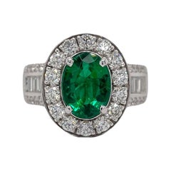Oval Emerald & Diamond Halo Ring in 18K White Gold