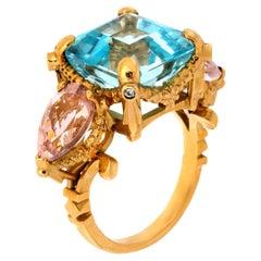 Florescence Garland Ring 9kt Yellow Gold, Blue Topaz, Pink Tourmalines, Diamonds