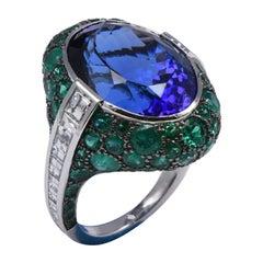18Kt White Gold Ring with White Diamonds, Emeralds, and Tanzanite
