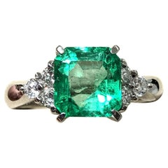 2.68 Carat Colombian Emerald and Diamond Three Stone Engagement Ring