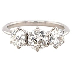 1.85 Carat Old Mine Cut Diamond Platinum Three Stone Ring